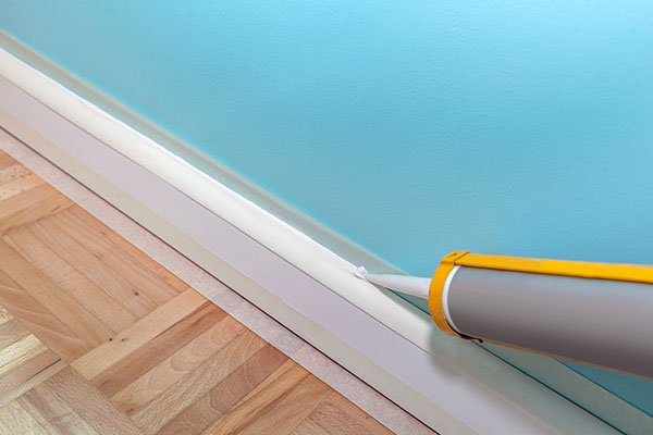 Can You Caulk Between Baseboards and Floorboards